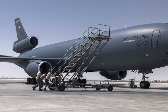 380th Aircraft Maintenance Squadron Extender Aircraft Maintenance Unit Airmen push a set of air stairs into position to offload aircraft crew August 3, 2017, at Al Dhafra Air Base, United Arab Emirates. Since April, maintenance Airmen made it possible to offload 96 million pounds of fuel to more than 8,000 refuelers. (U.S. Air Force photo by Senior Airman Preston Webb)