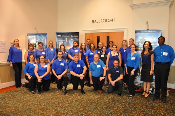 Employees of the Naval Surface Warfare Center Dahlgren Division (NSWCDD) pose for a photo before the start of a job fair held at the Fredericksburg Expo and Conference Center, July 18. The command's Human Resources Division announced Aug. 2 that it plans to make about 100 tentative job offers to candidates who attended the event. Approximately 325 candidates with bachelor's, master's, and doctoral degrees in biology, chemistry, computer science, engineering, mathematics, and physics spoke with senior Navy scientists, engineers, and managers about positions available for entry-level and experienced scientists and engineers.