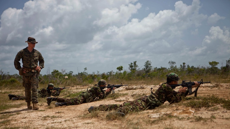 U.S. Marine Sgt. Cameron J. Earhart, an infantry trainer with the Belize Detachment, Ground Combat Element, Special Purpose Marine Air-Ground Task Force - Southern Command, trains service members with the Belize Defence Force in basic combat marksmanship near Ladyville, Belize, July 20, 2017. The training was part of basic infantry skills course taught by the detachment to members of the BDF. The Marines and sailors of SPMAGTF-SC are deployed to Central America from June to November 2017 to conduct security cooperation training and engineering projects with their counterparts in Belize, El Salvador, Guatemala, and Honduras.