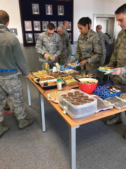 Airmen assigned to the 721st Aircraft Maintenance Squadron prepare plates during an Airmen Appreciation Dinner.