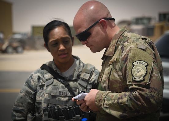 Master Sgt. Lance Moore (right), a 386th Air Expeditionary Wing weapons safety manager, runs down a checklist during a major accident response exercise Thursday May 25, 2017, at an undisclosed location in Southwest Asia. (U.S. Air Force photo by Tech. Sgt. Jonathan Hehnly)