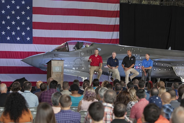 Jeff Babione, Lockheed Martin F-35 executive vice president and general manager (far left), is joined on stage by J.D. McFarlan, Lockheed Martin vice president of F-35 test and verification; Mike Glass, Lockheed Martin director of the Edwards ITF; and Fred Ross, LM vice president of program management.