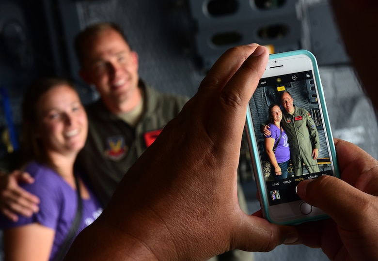 Maj. Richard, 432nd Wing MQ-1 Predator pilot, takes a photo with his cousin July 15, 2017, at the Lethbridge International Airshow in Alberta, Canada. Richard grew up near Lethbridge for 15 years and hasn't seen his cousin since he moved to the United States. (U.S. Air Force photo/Senior Airman Christian Clausen)