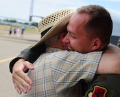 Maj. Richard, 432nd Wing MQ-1 Predator pilot, hugs his uncle July 15, 2017, at the Lethbridge International Airshow in Alberta, Canada. Richard had the opportunity to visit family and friends while displaying the MQ-9 Reaper at the airshow where he first fell in love with aviation. (U.S. Air Force photo/Senior Airman Christian Clausen)