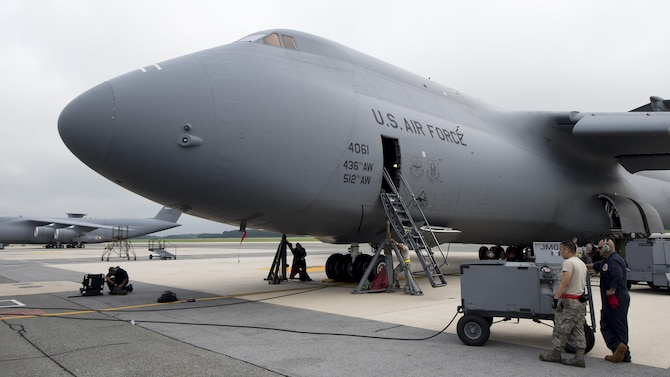 A C-5M Super Galaxy undergoes a nose landing gear maintenance operations check July 28, 2017, at Dover Air Force Base, Del. Maintenance crews inspected the nose landing gear of Team Dover's C-5M fleet to ensure that they are operating correctly and safely. (U.S. Air Force photo by Senior Airman Zachary Cacicia)