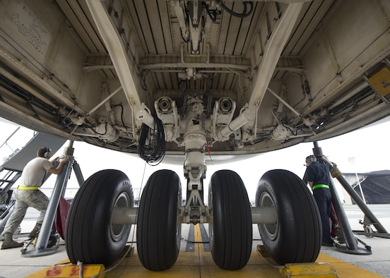 A C-5M Super Galaxy's nose landing gear undergoes a maintenance operations check July 28, 2017, at Dover Air Force Base, Del. Two C-5M nose landing gear malfunctions within a 60-day period during landings at Naval Air Station Rota, Spain, halted all Dover C-5M flight operations. (U.S. Air Force photo by Senior Airman Zachary Cacicia)