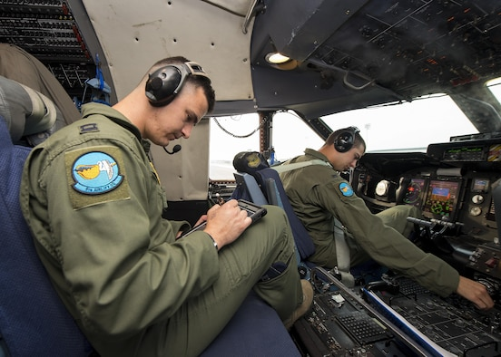 Capt. Gabriel Narvaez, 9th Airlift Squadron pilot, goes through preflight procedures prior to takeoff Aug. 2, 2017, at Dover Air Force Base, Del. Dover AFB is home to a fleet of 18 C-5Ms that provide Rapid Global Mobility. (U.S. Air Force photo by Senior Airman Zachary Cacicia)