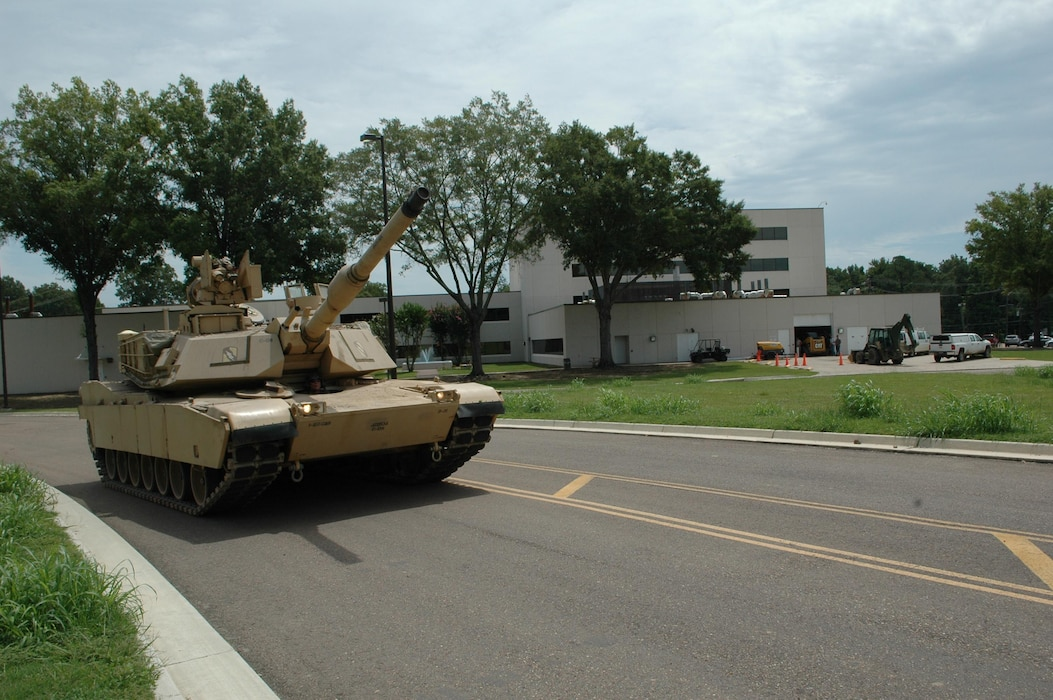 The M1A1 Abrams tank is shown arriving at the U.S. Army Engineer Research and Development Center's Geotechnical and Structures Laboratory. The Abrams tank is used in the Water Egress Terrain Surfacing Demonstration at GSL's ground vehicle terrain surfacing test facility.