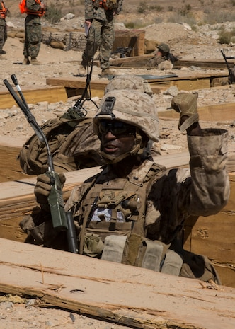 U.S. Marine Corps 1st Lt. Solomon S. Thomas, platoon commander with Echo Company, 2nd Battalion, 1st Marine Regiment, Marine Air-ground Taskforce-8 (MAGTF-8) gives an order while conducting Platoon hasty attack & maneuver range 410a during Integrated Training Exercise (ITX) 5-17 at Marine Corps Air Ground Combat Center, Twentynine Palms, Calif., July 22, 2017. The purpose of ITX is to create a challenging, realistic training environment that produces combat-ready forces capable of operating as an integrated MAGTF. (U.S. Marine Corps Photo by Cpl. Justin M. Smith)
