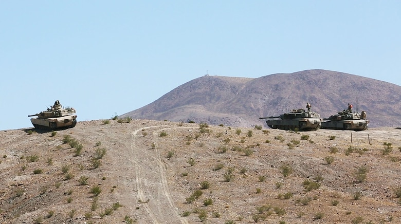 U.S. Marine Corps M1A1 Abram battle tanks with 1st Tank Battalion, Marine Air Ground Task Force-8 (MAGTF-8) scan for targets while conducting a Tank Mechanized Assault Course (TMAC) during Integrated Training Exercise (ITX) 5-17 at Marine Corps Air Ground Combat Center, Twentynine Palms, Calif., July 28, 2017. The purpose of ITX is to create a challenging, realistic training environment that produces combat-ready forces capable of operating as an integrated MAGTF. (U.S. Marine Corps Photo by Sgt. Kassie L. McDole)