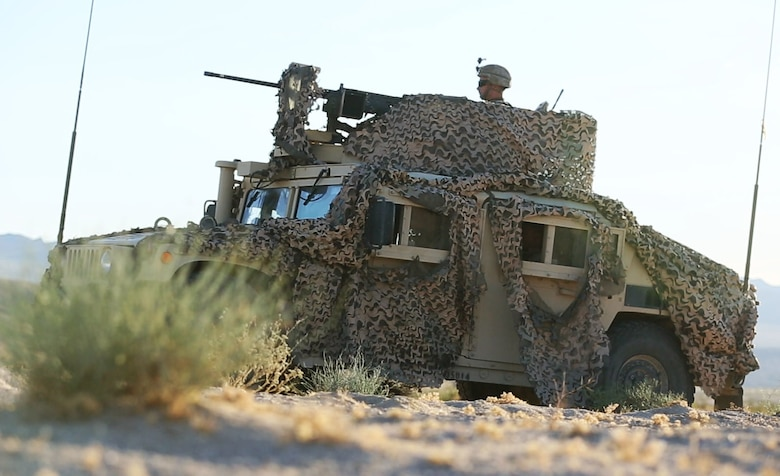 U.S. Marines with Combined Anti-Armor Team (CAAT), 1st Battalion, 1st Marine Regiment, Marine Air Ground Task Force-8 (MAGTF-8) provide security while conducting a Tank Mechanized Assault Course (TMAC) during Integrated Training Exercise (ITX) 5-17 at Marine Corps Air Ground Combat Center, Twentynine Palms, Calif., July 28, 2017. The purpose of ITX is to create a challenging, realistic training environment that produces combat-ready forces capable of operating as an integrated MAGTF. (U.S. Marine Corps Photo by Sgt. Kassie L. McDole)