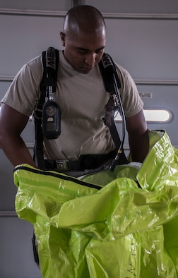 U.S. Air Force Tech. Sgt. Frederick Gilmore, readiness and emergency management flight chief assigned to the 6th Civil Engineer Squadron, dons a hazardous material (HAZMAT) suit at MacDill Air Force Base, Fla., Aug. 2, 2017. As emergency management, Gilmore is trained on how to handle any HAZMAT incident and chemical, biological, radiological and nuclear emergencies. (U.S. Air Force photo by Airman 1st Class Adam R. Shanks)