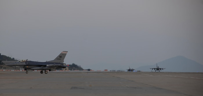 Three F-16 Fighting Falcons, or more commonly known as Vipers, assigned to the 176th Fighter Squadron, 115th Fighter Wing, Wisconsin Air National Guard taxi at Kunsan Air Base, Republic of Korea, Aug. 8, 2017. The 176th arrived at Kunsan to support the U.S. Pacific Command's security obligations in the Western Pacific as a part of a planned Theater Security Package deployment. The deployed unit will perform training under the support of the 8th Fighter Wing, testing the 176th's ability to integrate in a warfighter capacity and the Wolf Pack's ability to accept follow on forces in the event of a contingency.