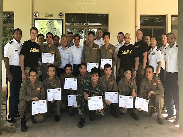 Soldiers from across U.S. Army Pacific, including EOD technicians from the 303rd Ordnance Battalion, 8th Military Police Brigade, 8th Theater Sustainment Command, in conjunction with Golden West Humanitarian Foundation held a closing ceremony and certificate presentation for 11 Vietnam Mine Action Training Center students on July 27, resulting in students' increased UXO De-mining technical knowledge while bringing them one step closer to International Mine Action Standards (IMAS) proficiency.