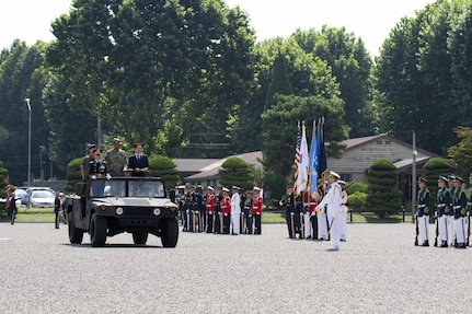 General Vincent K. Brooks, commander of United Nations Command, Combined Forces Command and United States Forces Korea, hosts a ceremony honoring the new Republic of Korea Minister of National Defense Song, Young-moo at U.S. Army Garrison Yongsan, Republic of Korea, Aug. 4. The visit was the Honorable Song's first time to U.S. Forces Korea headquarters since taking over as the MINDEF July 14. The ceremony included an inspection of the troops, a 19-gun salute and a presentation of one of the shell casings to honor the MINDEF.