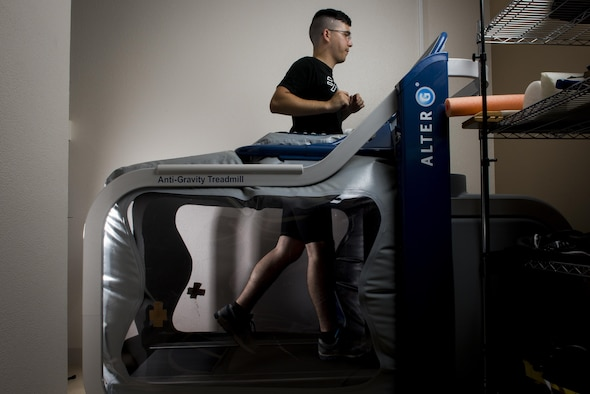 Airman 1st Class Taylor Drake, 730th Aircraft Mobility Squadron air freight, runs on an Anti-Gravity Treadmill July 28, 2017, at Yokota Air Base, Japan. The Anti-Gravity Treadmill allows people to run with a fraction of their actual body weight landing on their feet. (U.S. Air Force photo by Airman 1st Class Donald Hudson)