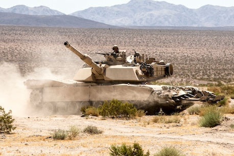 A U.S. Marine Corps M1A1 Abrams main battle tank with 1st Tank Battalion, Marine Air Ground Task Force-8 (MAGTF-8) maneuvers to the next objective while conducting a Tank Mechanized Assault Course (TMAC) during Integrated Training Exercise (ITX) 5-17 at Marine Corps Air Ground Combat Center, Twentynine Palms, Calif., July 28, 2017. The purpose of ITX is to create a challenging, realistic training environment that produces combat-ready forces capable of operating as an integrated MAGTF. (U.S. Marine Corps Photo by Sgt. Kassie L. McDole)