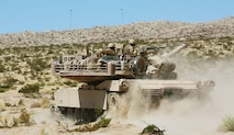 A U.S. Marine Corps M1A1 Abrams battle tank with 1st Tank Battalion, Marine Air Ground Task Force-8 (MAGTF-8) maneuvers to the next objective while conducting a Tank Mechanized Assault Course (TMAC) during Integrated Training Exercise (ITX) 5-17 at Marine Corps Air Ground Combat Center, Twentynine Palms, Calif., July 28, 2017. The purpose of ITX is to create a challenging, realistic training environment that produces combat-ready forces capable of operating as an integrated MAGTF. (U.S. Marine Corps Photo by Sgt. Kassie L. McDole)