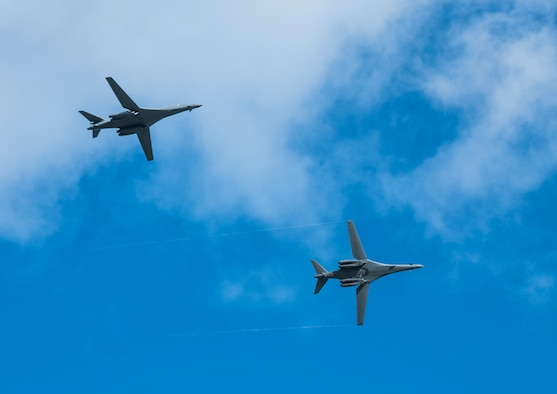 Two U.S. Air Force B-1B Lancers assigned to the 37th Expeditionary Bomb Squadron (EBS), deployed from Ellsworth Air Force Base (AFB), S.D., fly over Andersen AFB, Guam, July 26, 2017. The 37th EBS replaces the 9th EBS from Dyess AFB, Texas, which is currently supporting U.S. Pacific Command's Continuous Bomber Presence mission. Incorporating the B-1 into Pacific Command operations, exercises the Air Force's ability to integrate a unique capability with regional allies and partners in various parts of the world. (U.S. Air Force photo/Tech. Sgt. Richard P. Ebensberger)