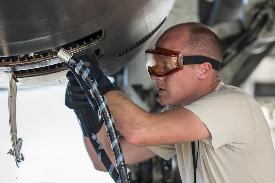 U.S. Air Force Tech. Sgt. Evan Williamson assigned to the 37th Expeditionary Maintenance Squadron, services a B-1B Lancer after it arrived at Andersen AFB, Guam July 26, 2017. The 37th EBS replaces the 9th EBS from Dyess AFB, Texas, which is currently supporting U.S. Pacific Command's Continuous Bomber Presence mission. (U.S. Air Force photo/ Airman 1st Class Christopher Quail)