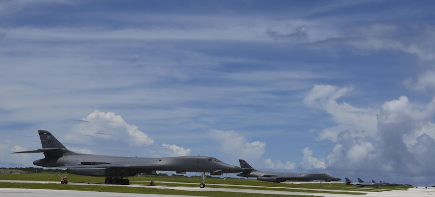 Twelve U.S. Air Force B-1B Lancers assigned to the 37th Expeditionary Bomb Squadron, deployed from Ellsworth Air Force Base (AFB), S.D. and the 9th EBS deployed from Dyess AFB Texas, line the airfield at Andersen AFB, Guam, July 31, 2017. The aircraft are deployed in support of U.S. Pacific Command's Continuous Bomber Presence operations. These aircraft, and the men and women who fly and support them, provide a significant capability that enables our readiness and commitment to deterrence, provides assurances to our allies, and strengthens regional security and stability in the Indo-Asia-Pacific region. (U.S. Air Force photo/Tech. Sgt. Richard P. Ebensberger)