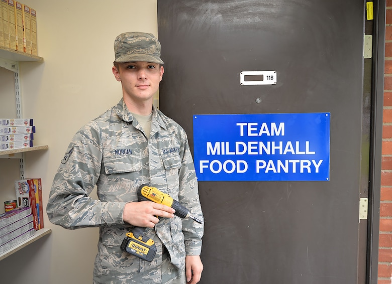 U.S. Airman 1st Class Austin Morgan, 100th Civil Engineer Squadron Structures apprentice, finishes putting up a sign for the Team Mildenhall Food Pantry Aug. 3, 2017, ready for the grand opening on RAF Mildenhall, England. The 100th CES is one of many agencies, including first sergeants and key spouses, who have worked hard to get the food pantry up and running for Team Mildenhall Airmen and their dependents in need. (U.S. Air Force photo by Karen Abeyasekere