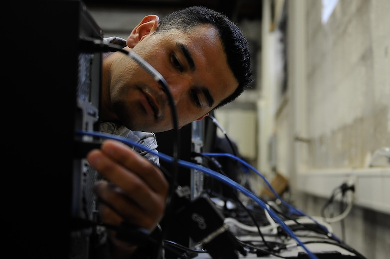 Senior Airman Eric Contreras, 86th Communications Squadron systems acquisitions technician, connects wires to new computers for imaging on Ramstein Air Base, Germany, Aug. 3, 2017. The National Security Agency has directed all of the Department of Defense to make the transition to Microsoft Windows 10. The NSA directive puts all branches of the military on the same operating system for the first time ever. (U.S. Air Force photo by Airman 1st Class Savannah L. Waters)