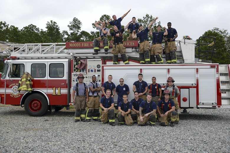 Firefighters from the 23d Civil Engineer Squadron pose for a photo after rapid intervention fire training, Aug. 3, 2017, at Moody Air Force Base, Ga. Rapid intervention refers to the rescue of downed firefighters when they find themselves in trouble. During the course, Moody firefighters, as well as a Lowndes County firefighter, learned how to perform self-rescue, team rescue, and basic skills such as CPR and various carries in order to transport victims. (U.S. Air Force photo by Airman 1st Class Lauren M. Sprunk)