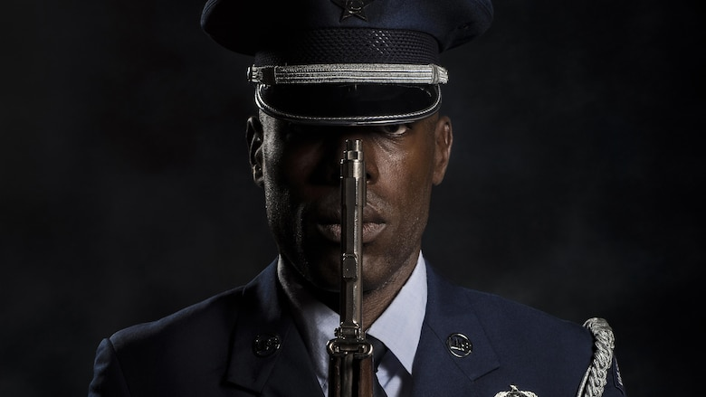 Tech. Sgt. Martin Wallace, 31st Fighter Wing Honor Guard lead instructor, represents his team of honor guard members as a photo is made of him on July 13, 2017, at Aviano Air Base, Italy. Wallace currently leads more than 30 Airmen who are working to become fully qualified honor guardsmen. (U.S. Air Force photo/Senior Airman Cory W. Bush)