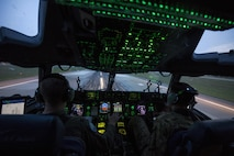Capts. Wes Sloat (left) and Jared Barkemeger, 7th Airlift Squadron pilots, operate a C-17 Globemaster III during takeoff from the flight line of Fort Bragg, N.C., during Operation Panther Storm, July 27, 2017. Panther Storm is a deployment readiness exercise used to test the 82nd Airborne Division's ability to rapidly deploy its global response force anywhere in the world with only a few hours' notice. (U.S. Air Force photo/Staff Sgt. Keith James)