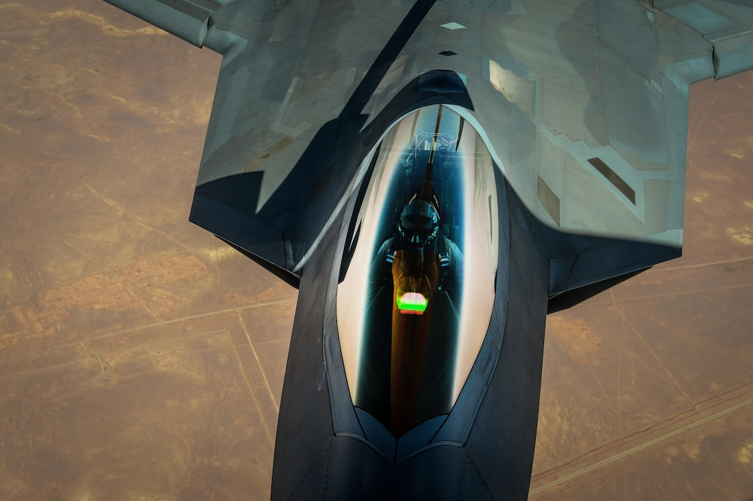 A F-22 Raptor receives fuel from a KC-135 Stratotanker during a mission in support of Operation Inherent Resolve July 31, 2017. The F-22 is a component of the Global Strike Task Force, supporting U.S. and Coalition forces working to liberate territory and people under the control of the Islamic State in Iraq and Syria. (U.S. Air Force photo/Staff Sgt. Michael Battles)