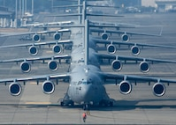 Four C-17 Globemaster III's and a C-130 Hercules line up in preparation for Mobility Guardian's elephant walk, Joint Base Lewis-McChord, Wash., Aug. 2, 2017. More than 3,000 Airmen, Soldiers, Sailors, Marines and international partners converged on the state of Washington in support of Mobility Guardian. The exercise is intended to test the abilities of the Mobility Air Forces to execute rapid global mobility missions in dynamic, contested environments. Mobility Guardian is Air Mobility Command's premier exercise, providing an opportunity for the Mobility Air Forces to train with joint and international partners in airlift, air refueling, aeromedical evacuation and mobility support. The exercise is designed to sharpen Airmen's skills in support of combatant commander requirements. (U.S. Air Force photo/Tech. Sgt. Jodi Martinez)