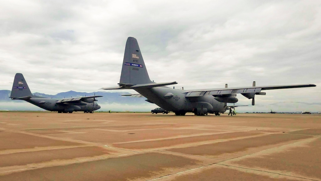 Two C-130H Hercules from the 94th Airlift Wing, Dobbins Air Reserve Base, Ga. are parked on the flightline at Peterson Air Force Base, Colo. Aug. 3, 2017. The two aircraft participated with other C-130s in high-altitude airdrops in the Colorado Rockies. (U.S. Air Force photo/Senior Airman Lauren Douglas)