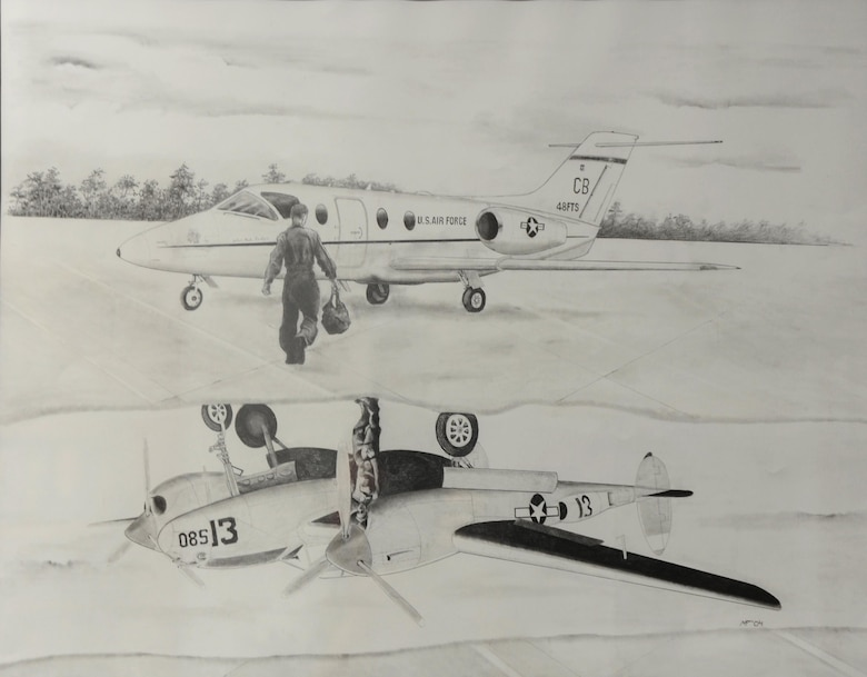 In this artist's heritage sketch, a Specialized Undergraduate Pilot Training student pilot prepares to fly a T-1A Jayhawk, the 48th Flying Training Squadron's current aircraft with a P-38 Lightning reflected in a puddle on the ramp. This drawing represents the past, present and future of the 48th Squadron. (U.S Air Force photo by Airman 1st Class Beaux Hebert)