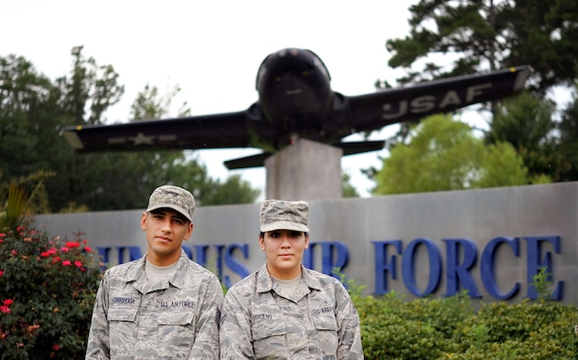 Staff Sgt. Luis Chiriboga, a 14th Civil Engineer Squadron engineering technician, and his wife, Airman 1st Class Estefania Briceno Ron, a personnel and administration technician assigned to the 14th Medical Support Squadron, stand at the entrance of Columbus Air Force Base, Mississippi. Chiriboga and Briceno Ron are both natives of Ecuador and received their U.S. citizenship after joining the Air Force. (U.S. Air Force photo by Staff Sgt. Chris Gross)
