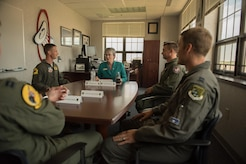 Photo of Air Force Secretary Heather Wilson meeting with 1st Fighter Wing pilots during her visit to Joint Base Langley-Eustis, Virginia.