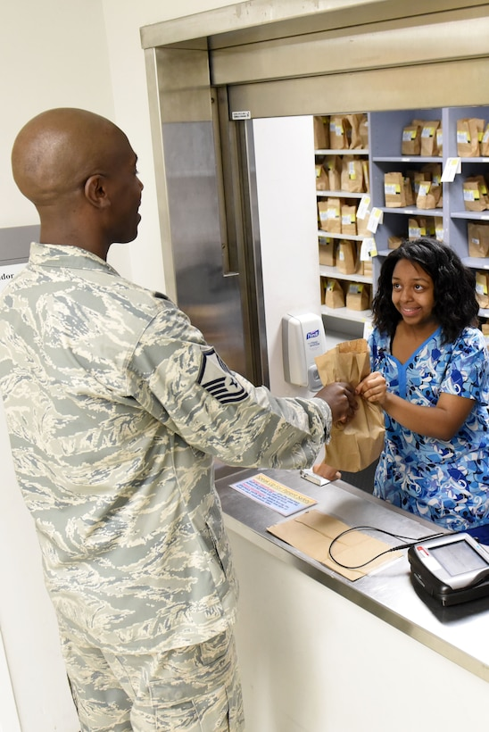 Master Sgt. Leon Russell, 4th Medical Support Squadron diagnostics and therapeutics flight chief, conducts prescription delivery training with Jhyana Price, Goldsboro Summer Youth Employment Initiative Program participant, July 19, 2017, at Seymour Johnson Air Force Base, North Carolina.