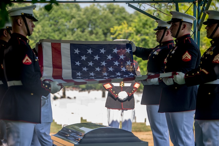 Marine Corps Body Bearers with Bravo Company, Marine Barracks Washington D.C., prepare to fold the National Ensign during a funeral for Marine Sgt. Julian Kevianne at Arlington National Cemetery, Arlington, Va., Aug. 3, 2017. Kevianne, 31, was one of the 15 Marines and one Navy sailor who perished when their KC130-T Hercules crashed in Mississippi, July 10, 2017. He was part of the Marine Aerial Refueler Transport Squadron 452, Marine Aircraft Group 49, 4th Marine Air Wing, based out of Stewart Air National Guard Base in Newburgh, NY. (Official U.S. Marine Corps photo by Cpl. Robert Knapp/Released)