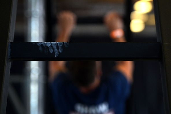 A hand is imprinted on a ladder rung at the Alpha Warrior Air Force Tour competition battle rig at Shaw Air Force Base, S.C., Aug. 2, 2017. The rig gave service members an opportunity to put their strength to the test through a series of obstacles including: a salmon ladder, which is an obstacle that consists of maneuvering a steel bar upward through five rungs, swinging monkey bars and an inverted ladder climb known as the devil steps. (U.S. Air Force photo by Senior Airman Christopher Maldonado)