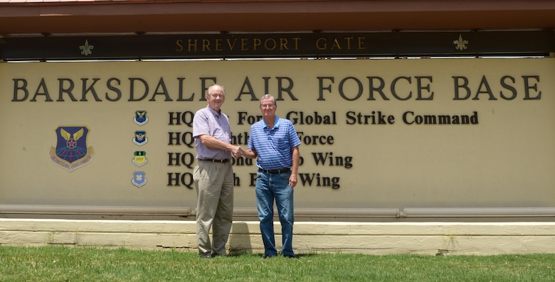 Forrest Carper, 2nd Force Support Squadron community readiness consultant, welcomes Larry Pierson to Barksdale Air Force Base, La., July 27, 2017.