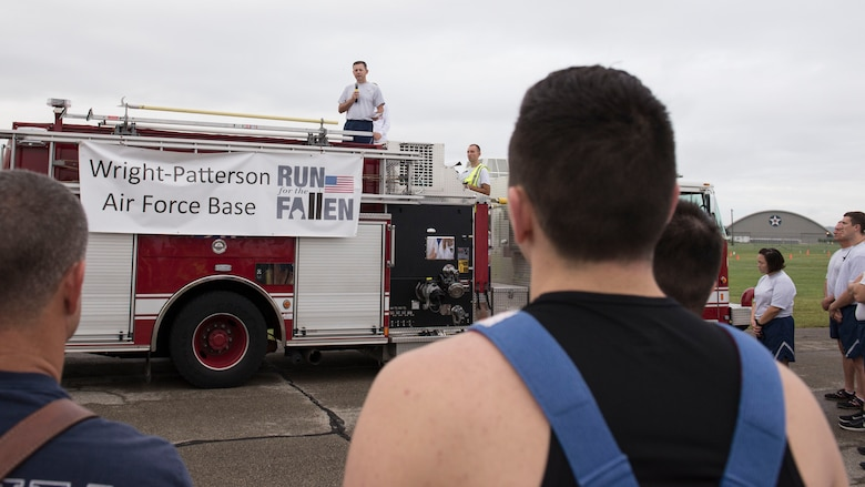 U.S. Air Force Col. Bradley McDonald, 88th Air Base Wing commander speaks to runners during the Run for the Fallen at Wright-Patterson Air Force Base, Ohio, September 9, 2016.  The Run for the Fallen provides an opportunity to remember and honor those who lost their lives and recognize those who continue to defend the nation. (U.S. Air Force photo/Michelle Gigante)