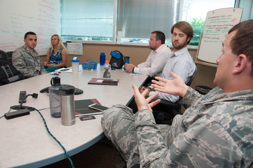 DAYTON, Ohio – 1st Lt. Connor Wiese (right), a development engineer with Team Wright-Patt, proposes an idea to his team during a brainstorming session Aug. 2 as part of the Air Force Research Laboratory Commander's Challenge 2017.  The challenge brings Airmen together from a wide-range of specialties to tackle a real-world problem with a maximum budget of $50,000 and six months to develop a working demonstration. (U.S. Air Force photo/John Harrington)