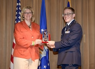 Wendy Kay, the director of Air Force Security Special Program Oversight and Information Protection, presents the William A. Davidson Award to Capt. Eric Diss, an Air Force Office of Special Investigations special agent, during the Davidson Award ceremony in the Pentagon, Aug. 3, 2017. Established in 2011, the award is named in honor of the retired AFOSI special agent and former administrative assistant to the Secretary of the Air Force for his leadership, service and dedication to the Air Force. (U.S. Air Force Photo/Andy Morataya)