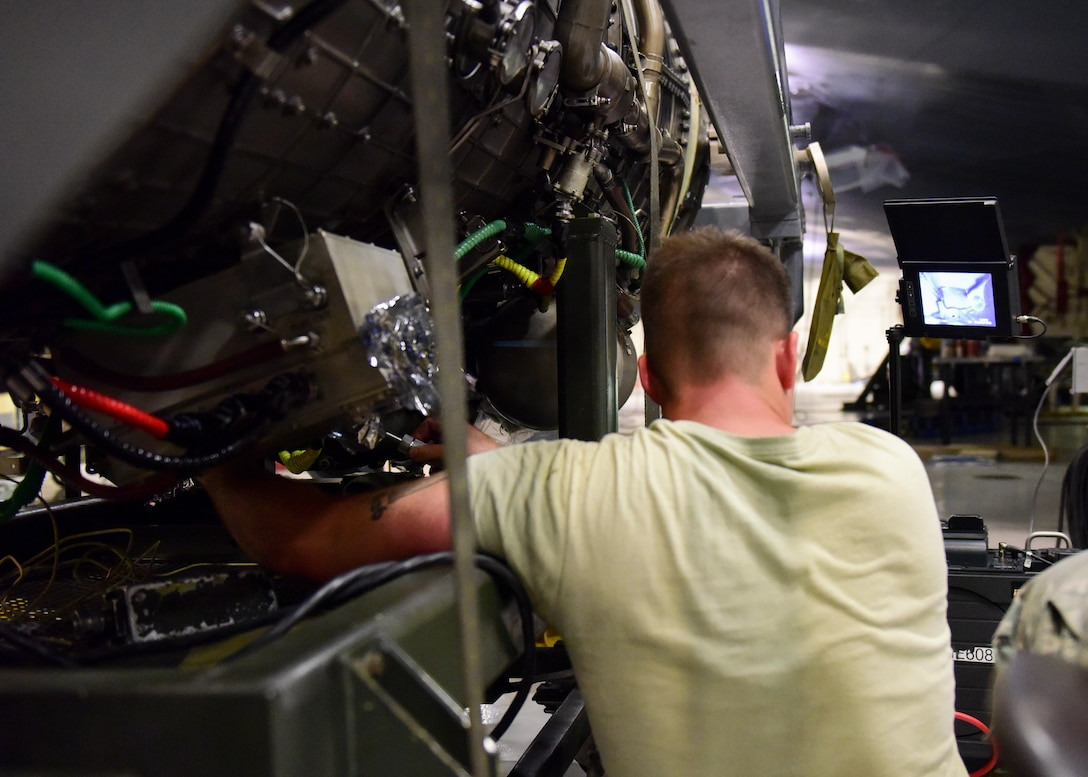 U.S. Air Force Senior Airman Charles Rutledge, an aircraft propulsion system journeyman 509th Aircraft Maintenance Squadron, examines the interior of a B-2 Spirit engine at Whiteman Air Force Base, Mo., July 27, 2017. Rutledge used a borescope, which helps view areas that would otherwise not be visible.