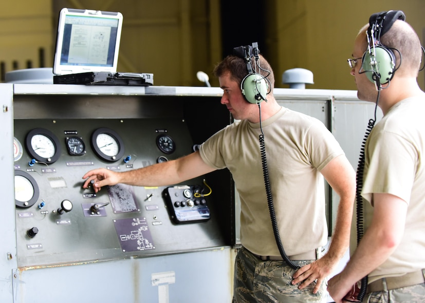 U.S. Air Force Tech. Sgt. Jeremy Garrow, left, an aircraft electrical and environmental system craftsman with the 509th Aircraft Maintenance Squadron (AMXS), and Staff Sgt. James Torrance, an aircraft electrical and environmental system craftsman with the 131st AMXS, monitor the cabin pressure during an annual test at Whiteman Air Force Base, Mo., July 27, 2017. These specialists are responsible for all the wiring and environmental control units on the aircraft.