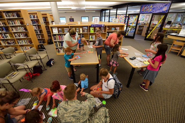 Members of Team Whiteman participate in the library's summer reading program at Whiteman Air Force Base, Mo., July 12, 2017. Around 300 children of all ages are involved in the three-month program. The program included self-paced reading, crafts, scavenger hunts and other fun activities.