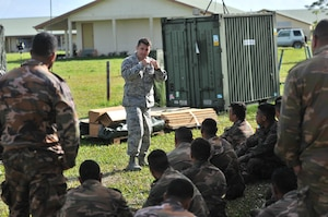 Senior Airman James Ward, a medical technician with the Nevada Air Guard's 152nd Medical Group, informs Tongan Soldiers about lifesaving techniques during Exercise Tafakula on the island of Tongatapu, Tonga, on July 20, 2017.