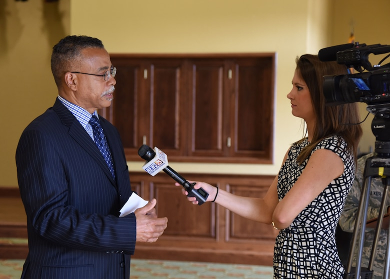 Laurene Callander, WXXV News 25 reporter, interviews Dr. Wayne Clark, 81st Mission Support Group deputy director during the Air Force Community Partnership Program Ideas Workshop at the Bay Breeze Event Center July 27, 2017, on Keesler Air Force Base, Miss. The program administrators are working to leverage military and local community capabilities and resources to achieve mutual value and benefit in support of the Air Force and its business partners. (U.S. Air Force photo by Kemberly Groue)