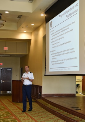 Lt. Col. Chris Miller, Secretary of the Air Force Installations, Environment and Energy partnership broker, delivers remarks during the Air Force Community Partnership Program Ideas Workshop at the Bay Breeze Event Center July 27, 2017, on Keesler Air Force Base, Miss. The program administrators are working to leverage military and local community capabilities and resources to achieve mutual value and benefit in support of the Air Force and its business partners. (U.S. Air Force photo by Kemberly Groue)