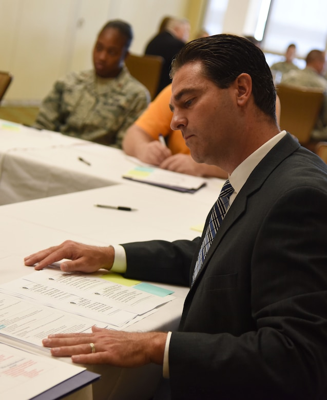 Chris McNees, Aerostar SES, LLC., program manager, leads the quality of life/community benefit group discussion during the Air Force Community Partnership Program Ideas Workshop at the Bay Breeze Event Center July 27, 2017, on Keesler Air Force Base, Miss. The program administrators are working to leverage military and local community capabilities and resources to achieve mutual value and benefit in support of the Air Force and its business partners. (U.S. Air Force photo by Kemberly Groue)